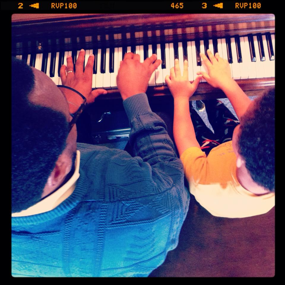 Papa (Mr. Burnett) and Owen playing a duet.